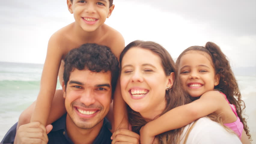 Family embrace and smiles on a beach