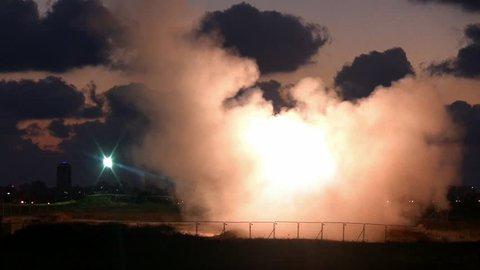 Iron Dome missile intercepts Hamas rocket during Gaza conflict operation Protective Edge, night vision shot.