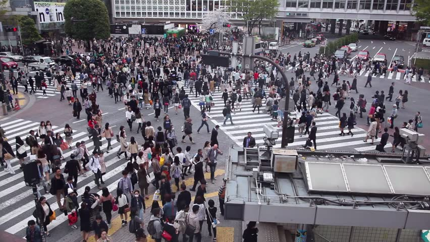 TOKYO, JAPAN - CIRCA APRIL 2014: People crossing the street, pedestrians walking, traffic. Shibuya Crossing, one of the busiest intersections in the world circa April 2014 in Tokyo, Japan, Asia | Shutterstock HD Video #6854902