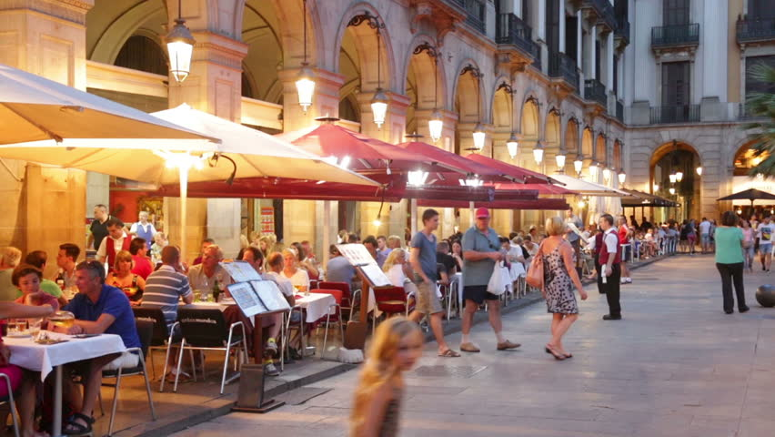 BARCELONA, SPAIN - JULY 18, 2014: Night view of Placa Reial with restaurants in summer. Barcelona, Spain