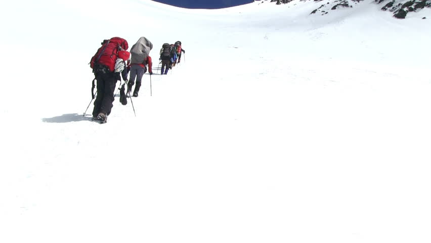 Climbers go up to the mountain pass