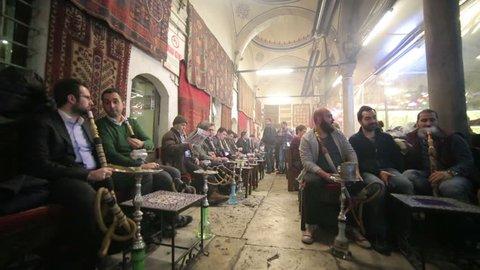ISTANBUL, TURKEY - JANUARY 2014: People smoking shisha at Nargile Cafe, Shisha place around Grand Bazaar