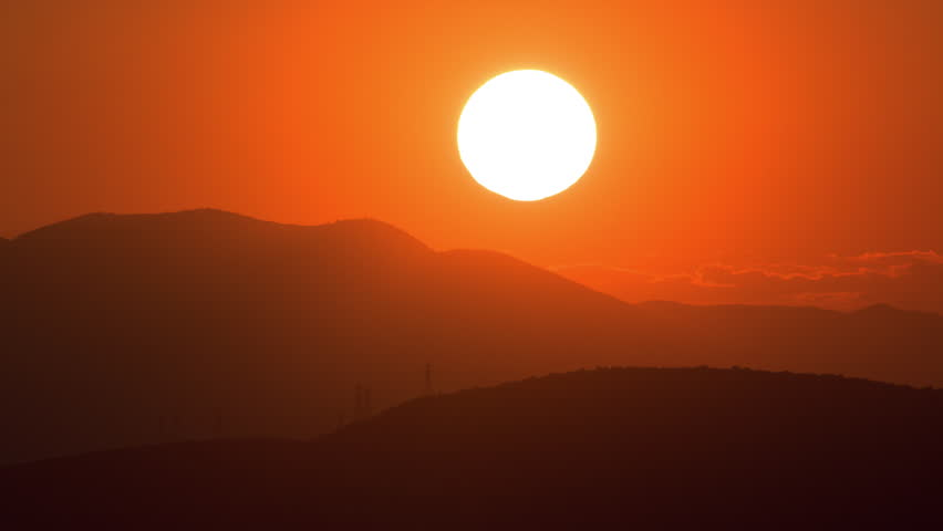 A beautiful close-up timelapse view of the sun setting behind mountains in Athens Greece. #6938002