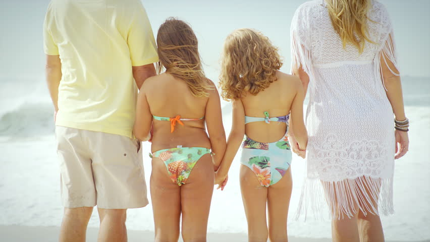 Loving Family Hold Hands And Stand Together On A Beach Stock Footage Video  Shutterstock