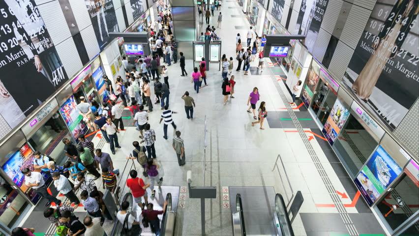 SINGAPORE - 13 NOVEMBER 2012: Timelapse of commuters taking the Singapore Subway (SMRT)