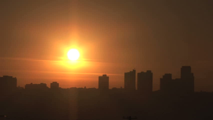 View of the city at sunrise - Time lapse. Colorful sky. | Shutterstock HD Video #6960382