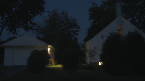 Driving plate, side view, night.  Tree-lined road through well-tended middle class suburban neighborhood with 1940s & 1950s era Cape Cods, bungalows and similar homes.  Recorded on Tyler Mini Gyro.