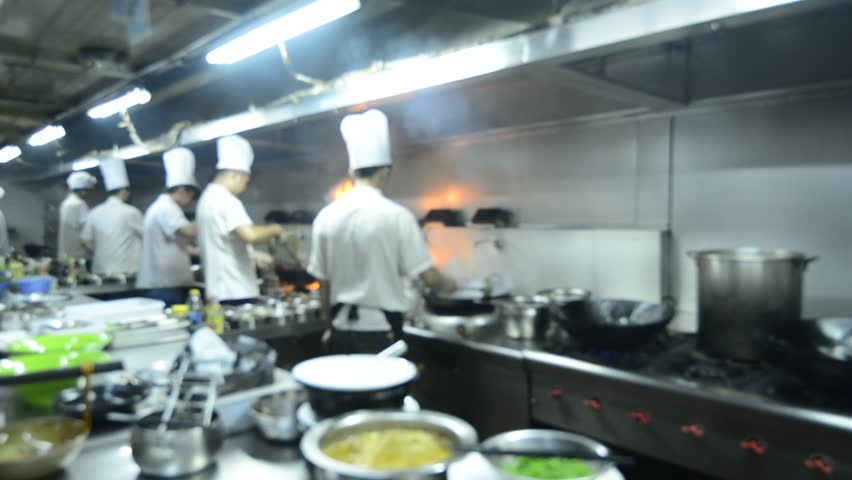 Restaurant Kitchen Video motion chefs of a restaurant kitchen stock footage video 5285246
