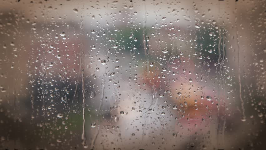 Rain Drops On Window Glass ,bokeh Lights Traffic Lights In ...