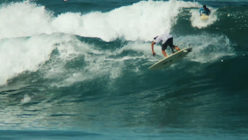 A surfer on a shortboard rides on a wave   Shutterstock HD Video #7025992