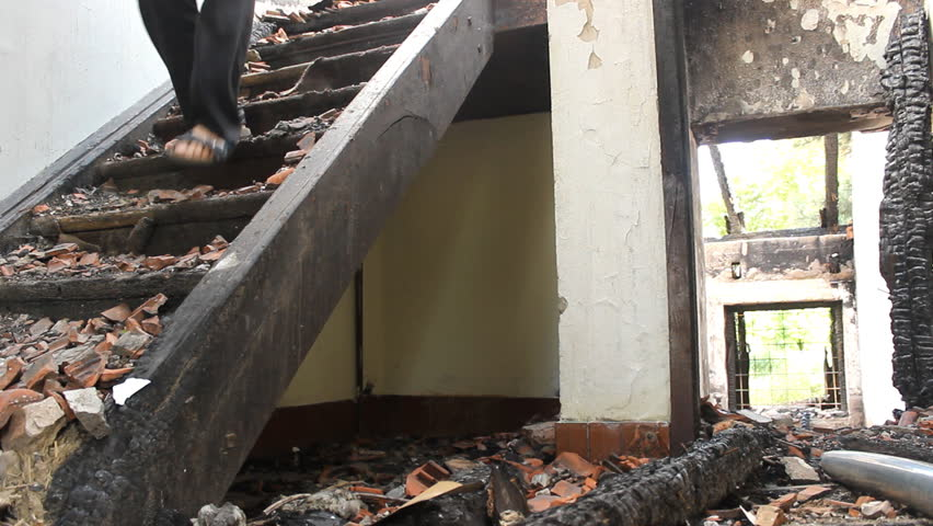 Walking on stairs  man in Ruined  house | Shutterstock HD Video #7029532