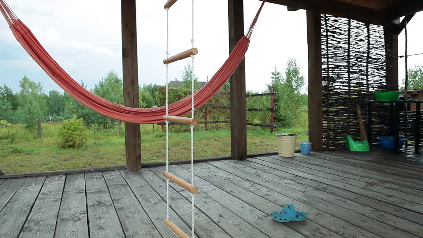 Nice Summer Wooden Terrace With Hammock And Swing In Pine Woods Of Russia. Empty  Open Air