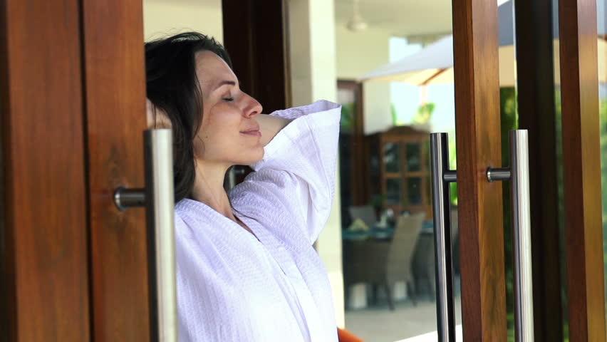 Beautiful woman open doors enjoying beautiful morning - HD stock video clip