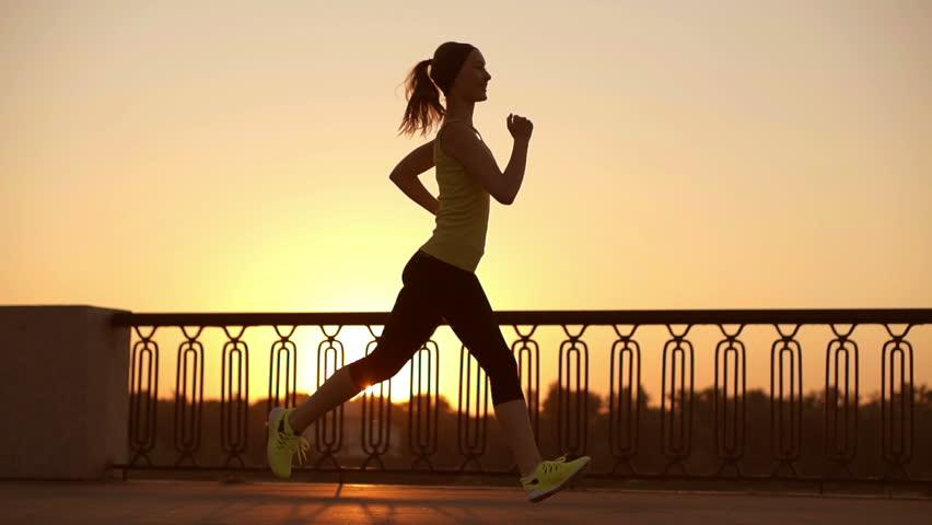 Running Woman. Runner is Jogging Video de stock (totalmente ...