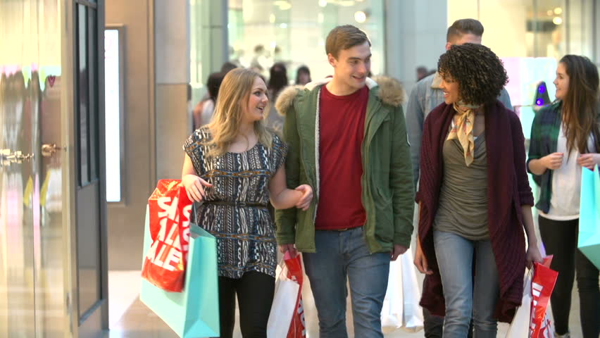 Slow Motion Sequence Of Friends Shopping In Mall Together  | Shutterstock HD Video #7090867