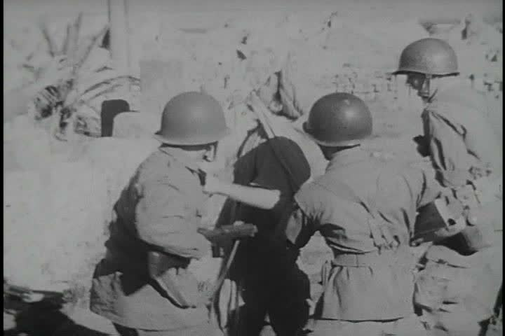 CIRCA 1950s - The Algerian revolt against French colonial rule begins in 1954. People are shot point blank.