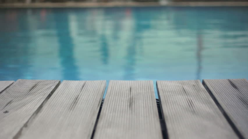 Wooden Deck On Rippled Swimming Pool Water Background