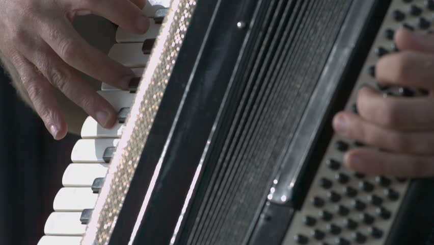 Close up on hands playing accordion in slow motion. #7127422