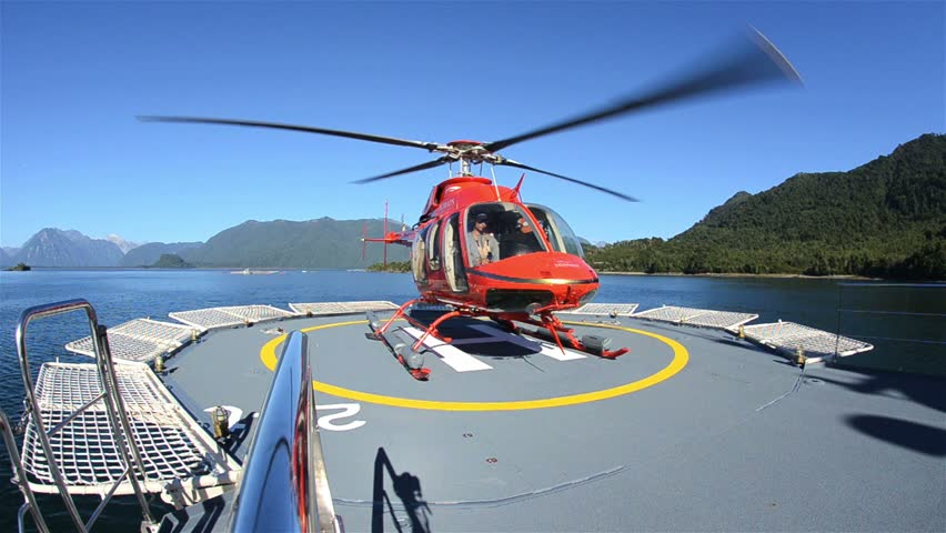 CHILE, CIRCA 2013 - Low angle of a helicopter taking off from a ship helipad near Chait\xED\xA9n in Northern Patagonia in Chile.