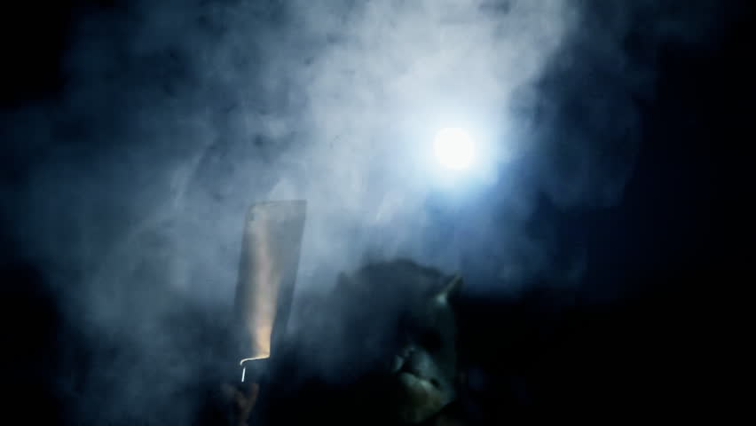 A masked killer suddenly appears in a full moon night, between a thick smoke or fog.  | Shutterstock HD Video #7174912