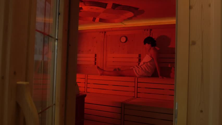 Hispanic Woman In Sauna Relaxing, Ambiance With Red Light. 4k,high  Resolution