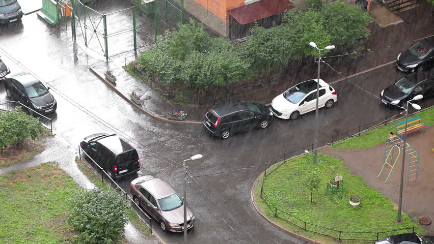 Strong rain in courtyard of apartment building, aerial view point, Russia