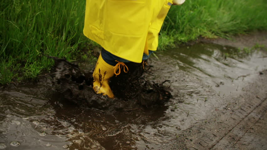 Happy girl and little boy in rubber boots and bright for Puddle of fish