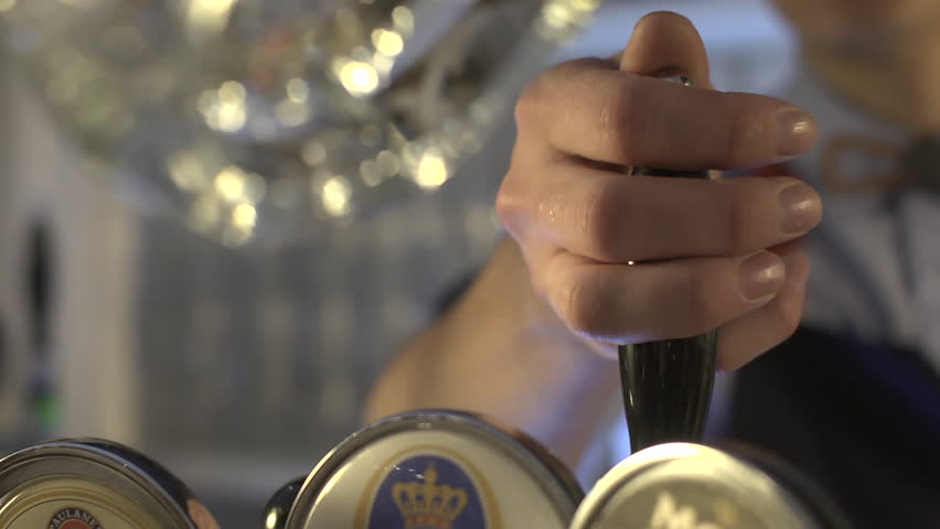 Stock video footage bar beer being poured into a glass