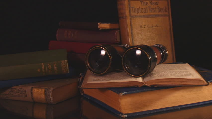 Vintage binoculars and books with black background- hd