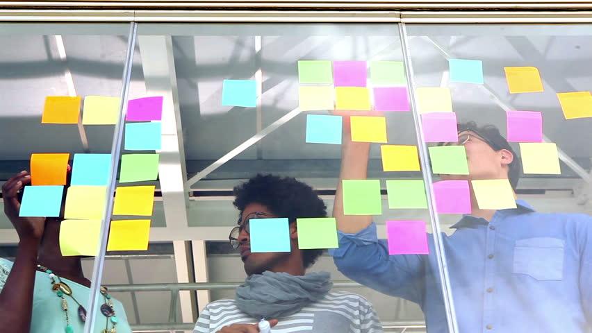 Creative business team having a meeting in creative office | Shutterstock HD Video #7253854