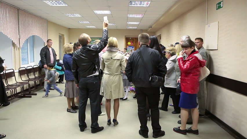 SAINT-PETERSBURG, RUSSIA - September, 1, 2014: Parents photograph schoolchildren when they stand in school hall in line. Day of Knowledge in Russia is beginning of the school year | Shutterstock HD Video #7261012