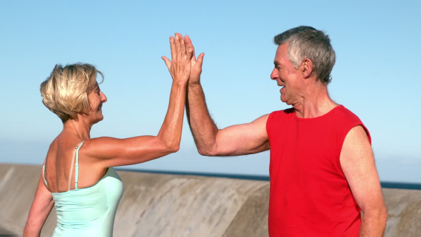 Senior couple high fiving after a jog in slow motion | Shutterstock HD Video #7283932
