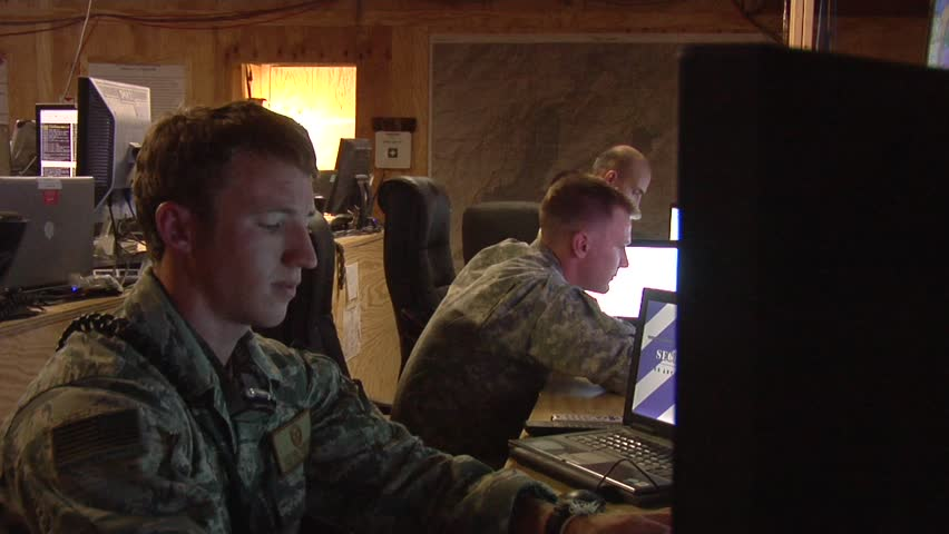 Afghanistan, Circa 2010: Military personnel working at their computer station as part of the Coalition Forces in Afghanistan, Circa 2010.