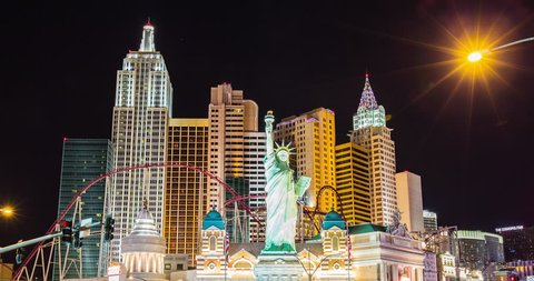 LAS VEGAS CIRCA 2014 - Night time time lapse of the Las Vegas strip - Panning down from the New York, New York hotel and resort to the road, US, April, 2014