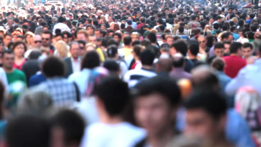 Street filled with a very busy anonymous crowd   | Shutterstock HD Video #735991