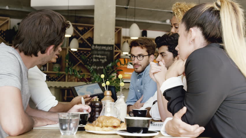 Small Business team meeting global sharing economy tablet touchscreen cafe | Shutterstock HD Video #7360543