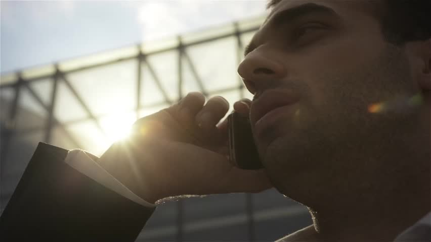 Closeup of young businessman calling on mobile phone, outdoor. | Shutterstock HD Video #7372522
