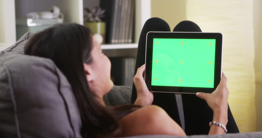 Mixed race woman laughing with tablet | Shutterstock HD Video #7378396