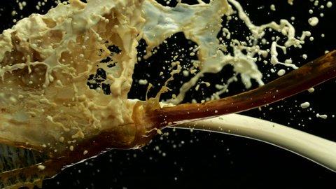 Coffee and milk collision splash in midair shot with high speed camera, phantom flex.