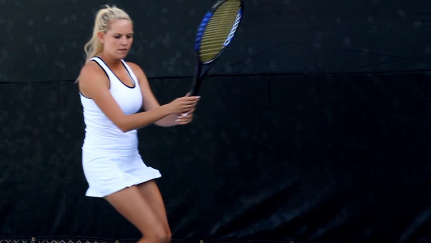 Female tennis player in action. Slow motion conformed from 60fps.