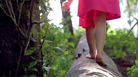 Little Girl Walks, Then Runs, Down A Log (Away From Camera)