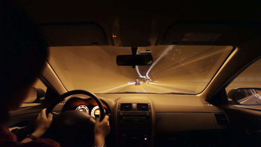 Timelapse of driving through tunnel. Shot from vehicle interior (POV).