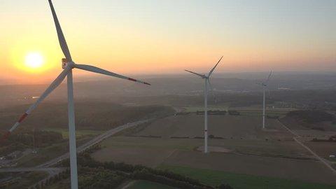 4K. Aerial shot of Power Generating Windmills. Wind turbines producing clean renewable energy.