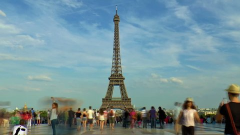 PARIS, FRANCE - AUGUST 4: People timelapse in front of Eiffel Tower on AUGUST 4, 2014 in Paris, France. Eiffel Tower is the tallest structure in Paris.