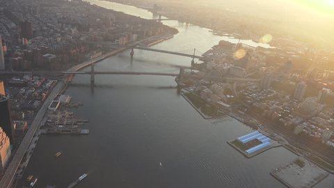New York City East River, Brooklyn Bridge sunrise and early morning light. Shot in 4K, dedicated plane, hard mounted open window allows a saturated, clear edge on the shot.