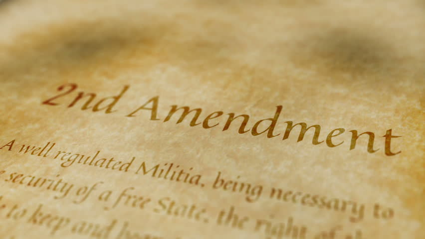 scrolling text on an old paper background of the contents of the scrolling text on an old paper background of the contents of the 2nd amendment to the united states constitution that states the right of citizens to bear