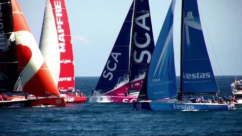 """ALICANTE, SPAIN - OCTOBER 03: Starting the """"In Port Race"""" for the """"Volvo Ocean Race 2014-2015"""" in Alicante bay. All Volvo sailboats are fighting for the head, on october 04, 2014 in Alicante."""