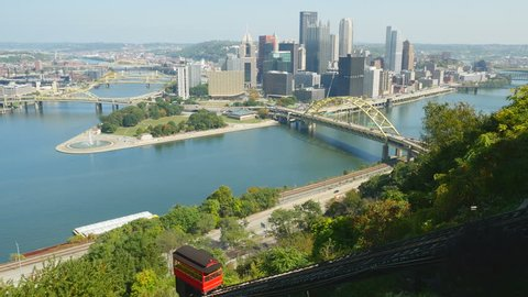 The Duquesne Incline ascends Mt. Washington with a view of downtown Pittsburgh, Pennsylvania, at the confluence of the Allegheny and Monongahela Rivers, in the background