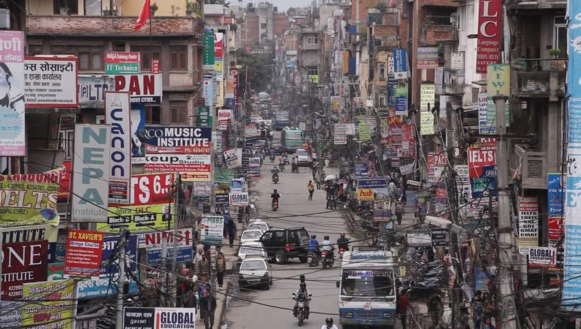 KATHMANDU, NEPAL - OCT 25: The traffic on on the streets at Thamel, Nov 30, 2013 in Kathmandu, Nepal. People, cars, motorbikes and rickshaws on the street