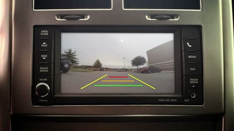 A car's backup camera in action. With green screen and optional luma matte for your custom imagery.